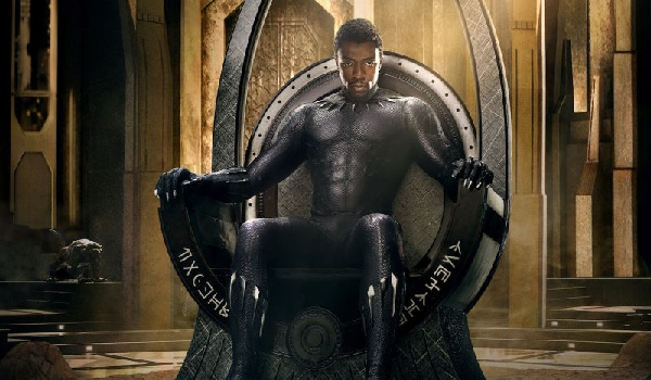 Promo photo of Chadwick Boseman as Black Panther sitting on his throne